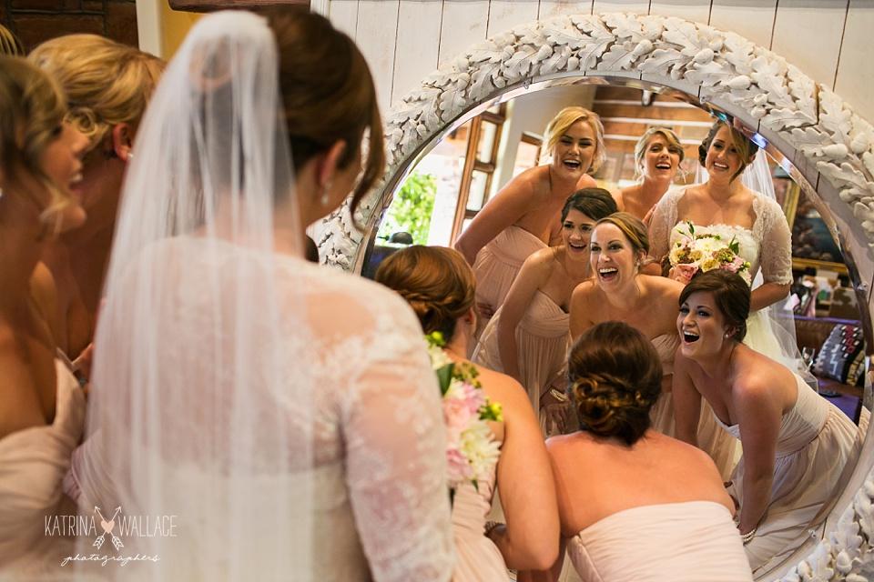 bridal party in a mirror