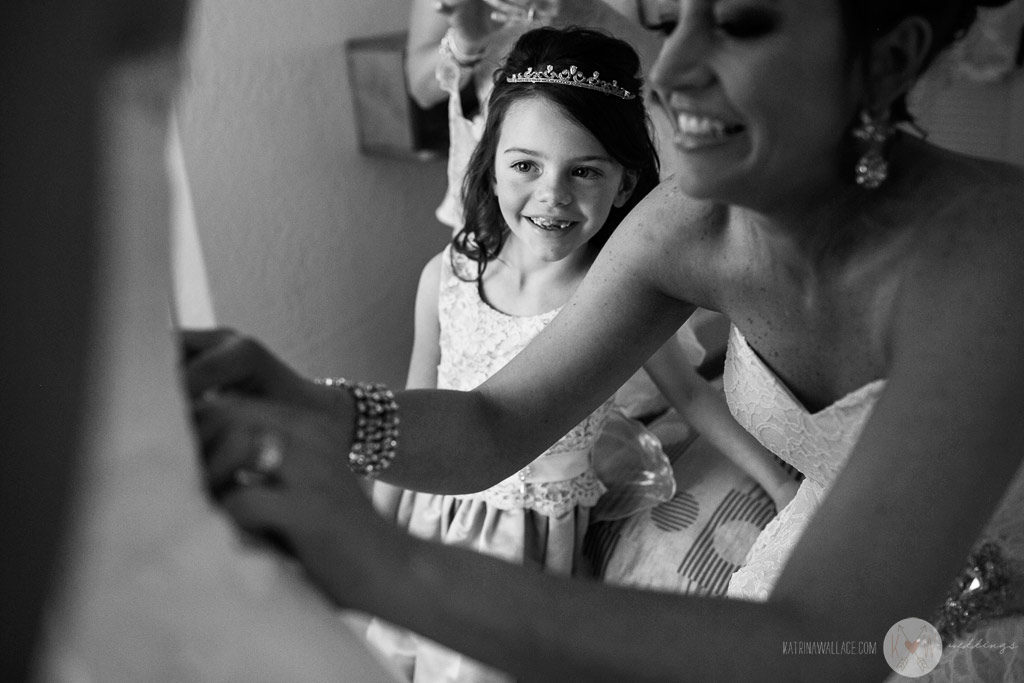 The flower girl follows every move the bride makes as she gets ready for her Brophey Chapel wedding ceremony