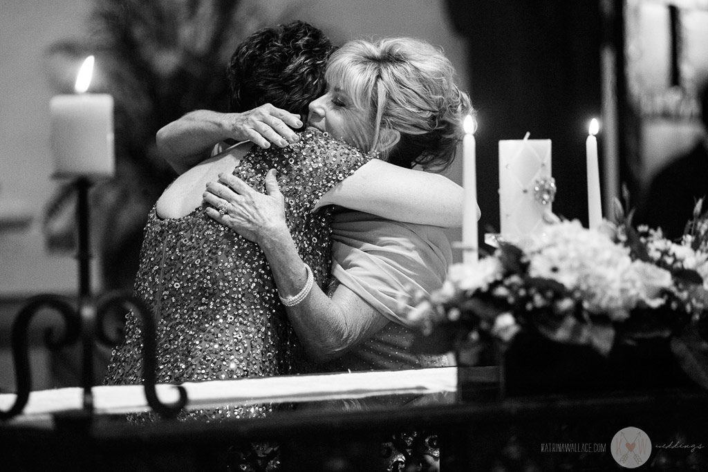 The mothers of the bride and the groom have a hug as they participate in the Brophey Chapel ceremony