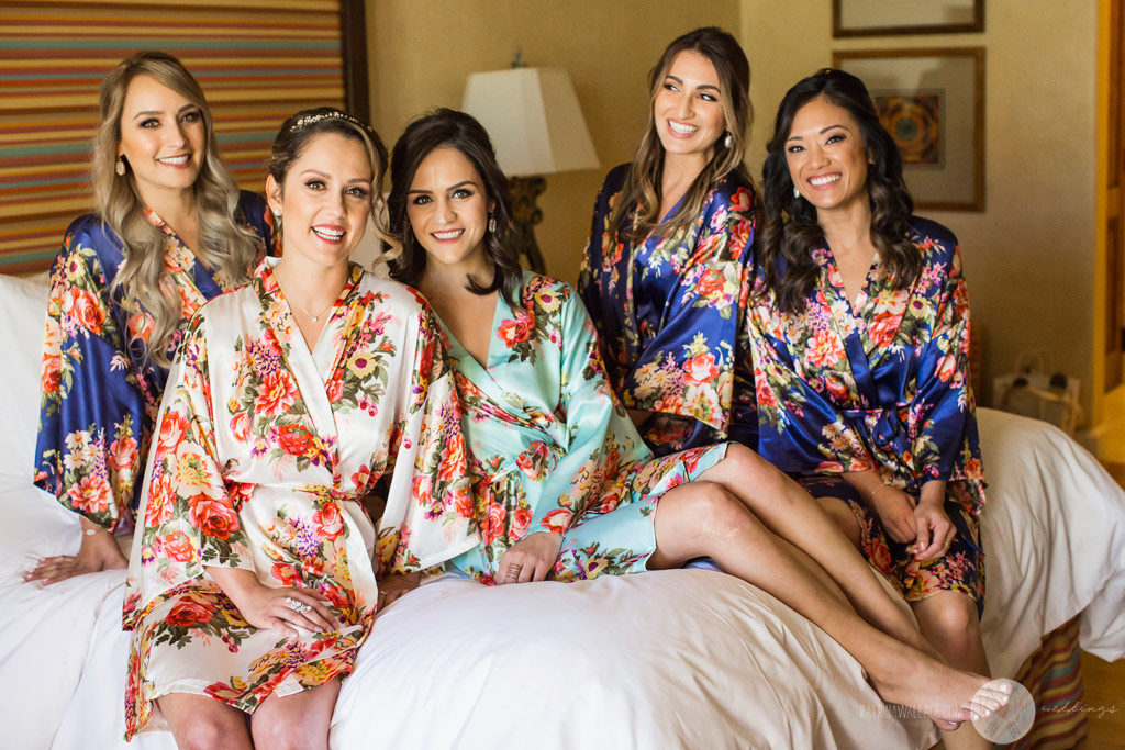 The bridesmaids pause for a casual group shot in their robes during preparation for the wedding at the Four Seasons Scottsdale