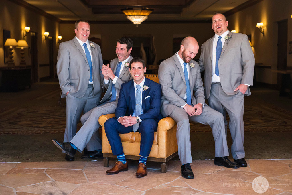 The groomsmen have a difficult time being serious for a group shot before the ceremony at the Four Seasons Scottsdale