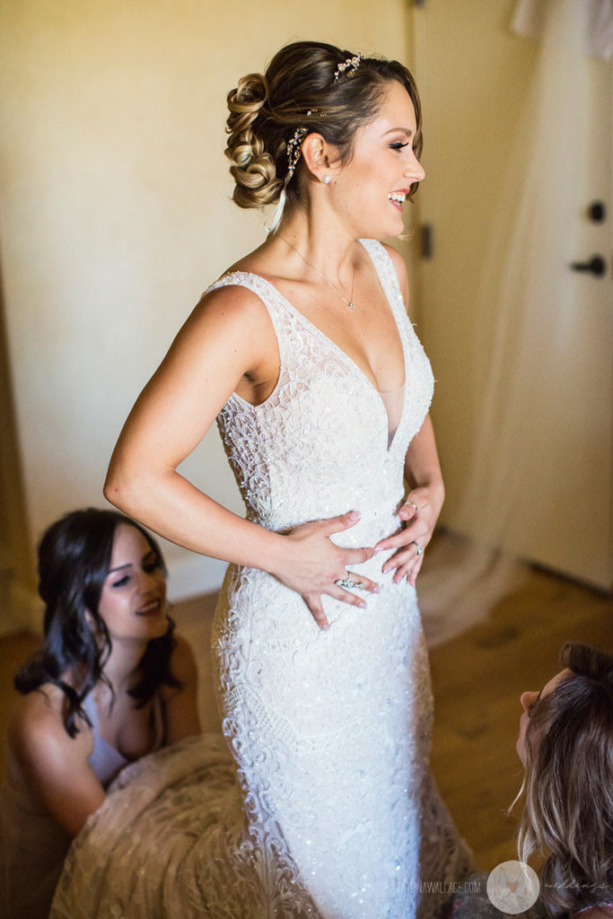 After getting into her gown, the beautiful bride blushes with excitement as the ceremony draws nearer at the Four Seasons Scottsdale
