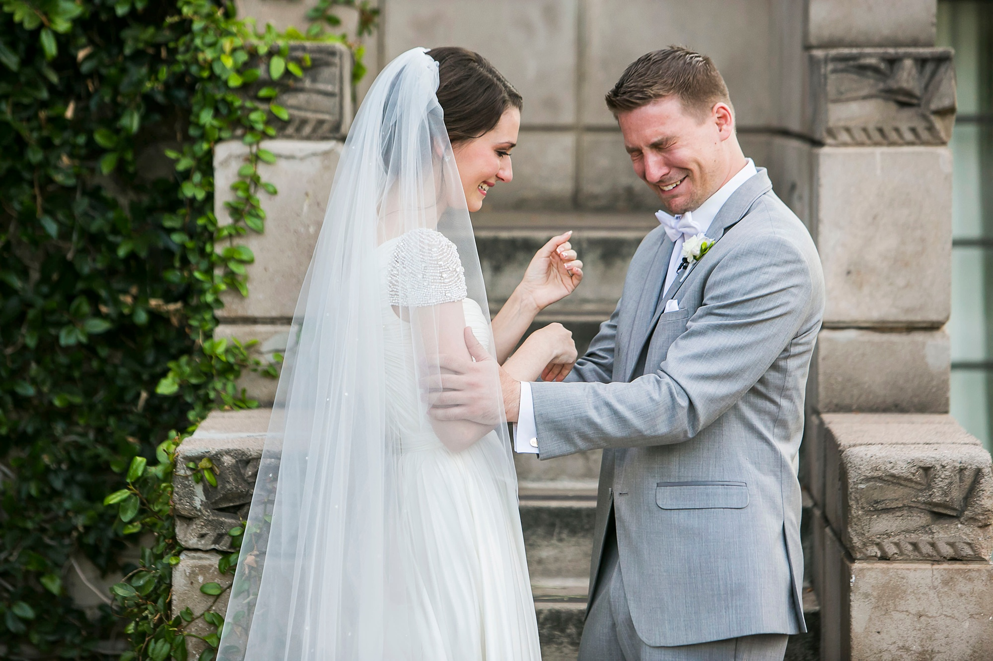 Emotional groom crying during his first look with is bride at an Arizona Biltmore wedding by Victoria Canada Weddings