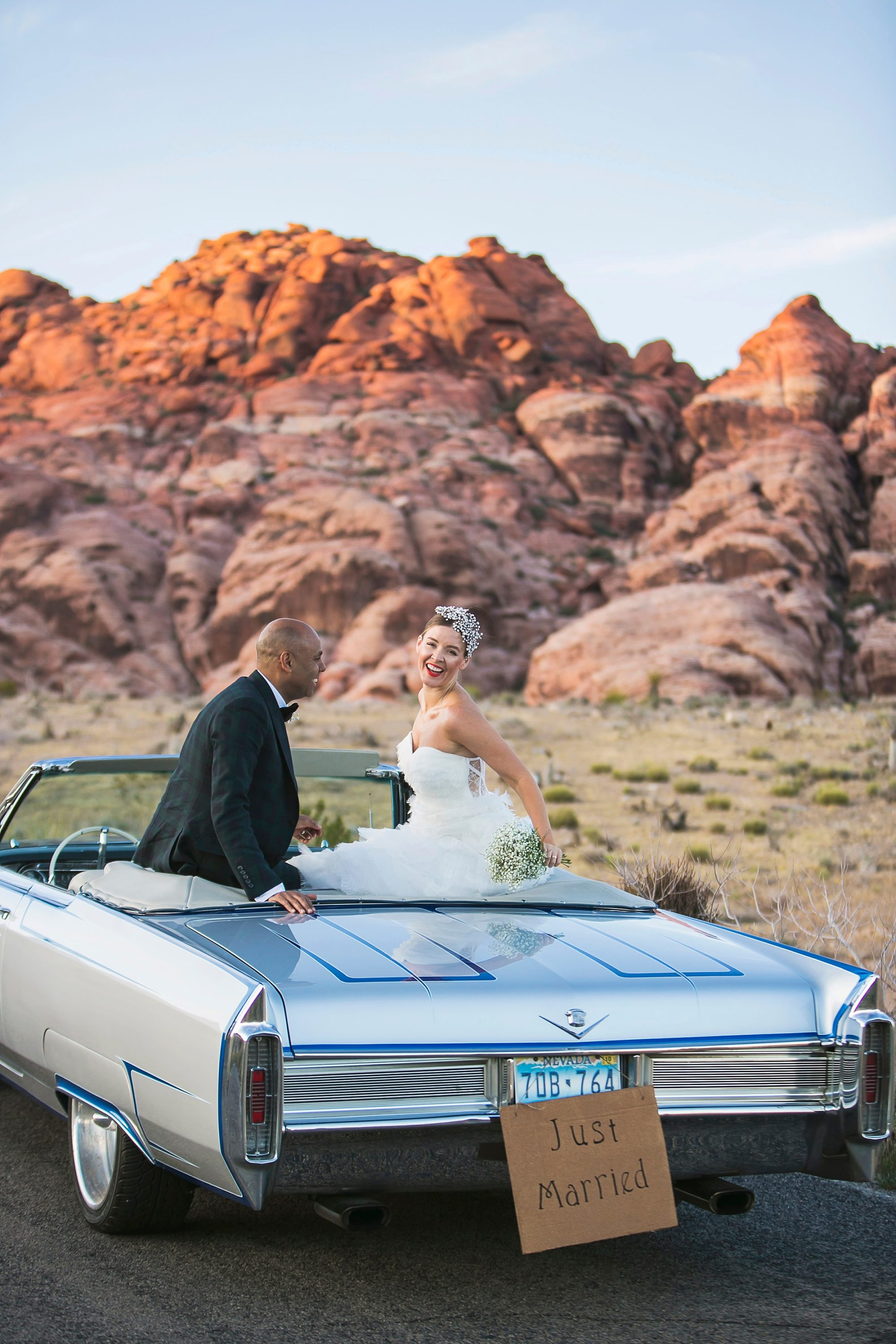 Red Rock Canyon NV elopement with a bride and groom riding in a convertible