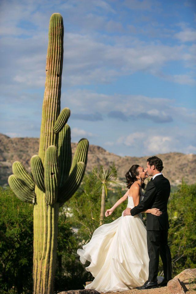 Sanctuary Resort wedding photos of a bride and groom next to a saguaro cactus